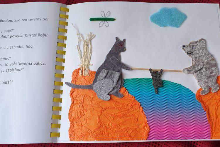 Stránka z knihy Medvedík PÚ s reliéfnym obrázkom.